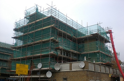An independent scaffold showing all elevations and a rubbish chute. Erected under The London Borough of Haringey regeneration program.
