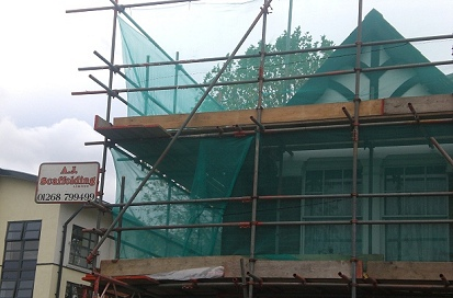 Debris netted independent scaffold for The London Borough of Havering housing program.