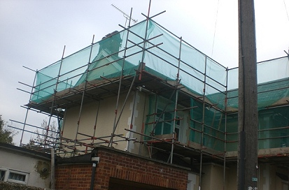 Debris netted independent scaffold for the Houses in Haringey program.